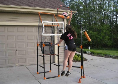 volleyball player using spike trainer at home from The Edge Pro Volleyball Trainer