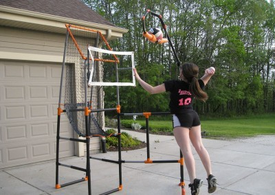 Club volleyball girl using a volleyball spike trainer from The Edge Pro Volleyball Trainer