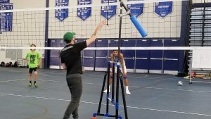 Coach using The Edge Independent hitting machine