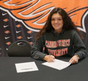 The Edge Pro Volleyball Trainer and girl signs volleyball scholarship